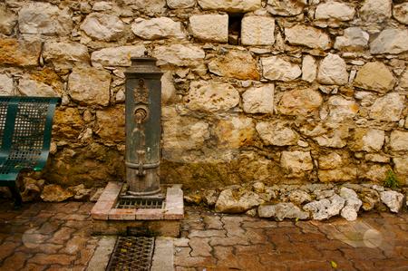 Ancient Brick Wall and Water Pump stock photo, Ancient Brick Wall and Water Pump by Andy Dean