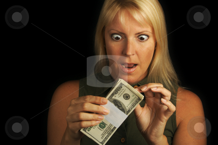 Money In Hand stock photo, Attractive Woman Excited About her Stack of Money She Holds by Andy Dean