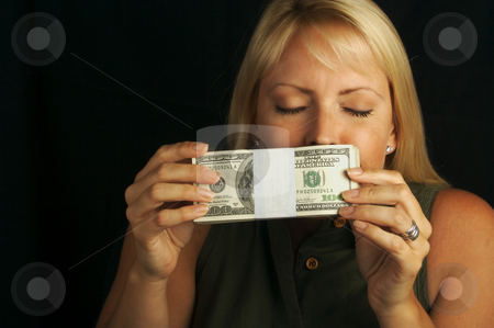 The Smell of Money stock photo, Attractive Woman Enjoys the Smell of Her Stack of Money by Andy Dean