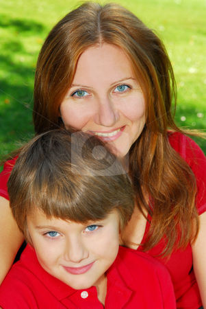 Mother and son stock photo, Portrait of smiling mother and son in summer park by Elena Elisseeva