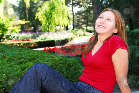 Woman relaxing stock photo, Mature woman relaxing outside in summer park by Elena Elisseeva