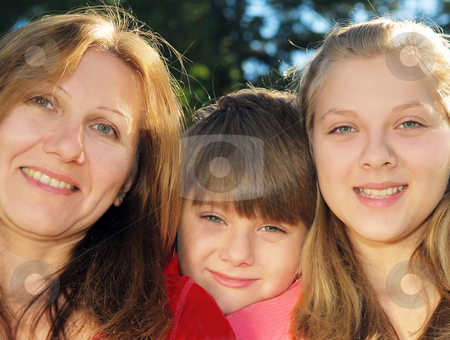 Family portrait stock photo, Portrait of a smiling family of mother and her children by Elena Elisseeva