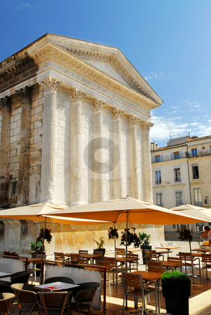Roman temple in Nimes France stock photo, Roman temple Maison Carree and outdoor cafe in city of Nimes in southern France by Elena Elisseeva