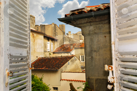 View in Cognac stock photo, View from an open window with shutters in town of Cognac, France by Elena Elisseeva
