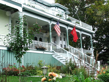 Comfortable vintage house stock photo, Colorful decor with wonderful landscaping makes this interesting old wood frame home with expansive front porch in Boothbay Harbor, Maine stand out from the neighbors (photo 10/08/07). by Dennis Thomsen