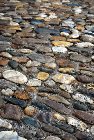 Cobblestone background stock photo, Abstract background of old medieval cobblestone pavement by Elena Elisseeva