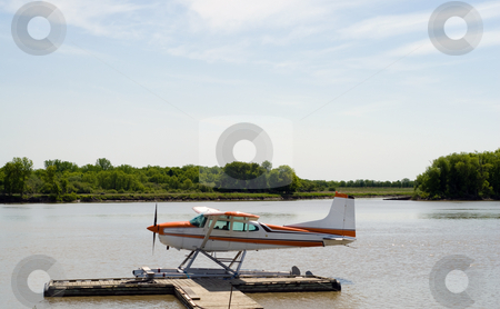 Seaplane stock photo, A seaplane parked along a wooden dock on the river by Richard Nelson
