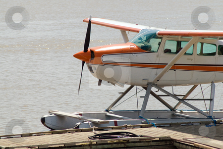 Close-up Seaplane stock photo, Close-up view of a seaplane floating on a river by Richard Nelson