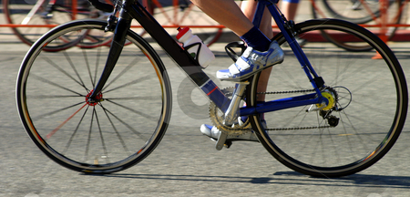 Bike Race stock photo, Moving tires with a close few of a bike race. by Henrik Lehnerer