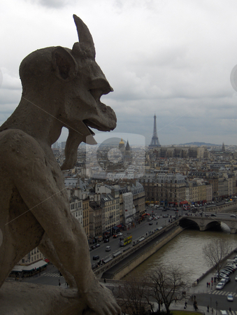 Gargoyle stock photo, A gargoyle's view of Paris, including the Seine River and the Efiiel Tower, taken from atop the Notre Dame Cathedral. by Jessica Tooley
