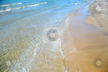 Beach wave sand stock photo, Waves on sandy beach closeup by Elena Elisseeva