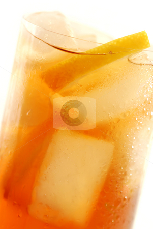 Lemon iced tea stock photo, Glass of cold lemon iced tea with ice and lemon, water drops on surface by Elena Elisseeva