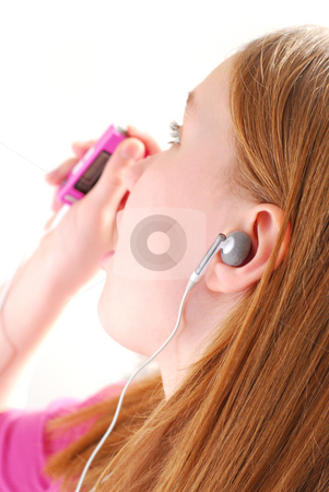 Girl listen music stock photo, Young girl listening to music on her mp3 player white background by Elena Elisseeva