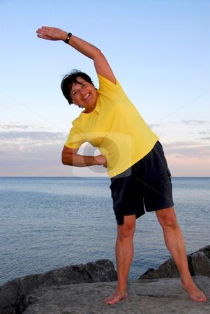 Mature woman exercising stock photo, Mature woman exercising outside by Elena Elisseeva