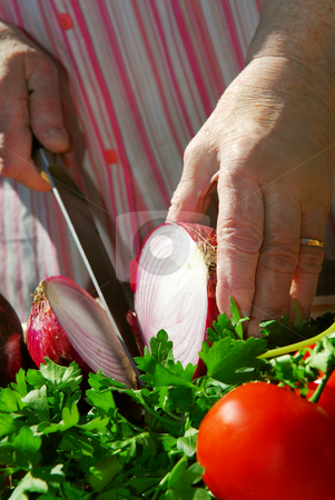 Grandma cooking stock photo, Hands of an elderly woman cooking with fresh vegetables by Elena Elisseeva