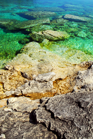Rock and water background stock photo, Rock and clear water of Georgian Bay at Bruce peninsula Ontario Canada by Elena Elisseeva