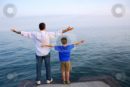 Father son ocean stock photo, Father and son on a pier relaxing together by Elena Elisseeva