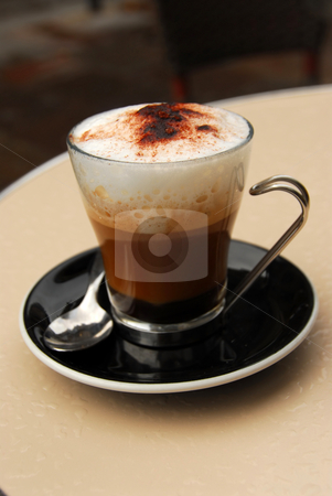 Cappuccino stock photo, Cup of cappuccino coffee on a restaurant table by Elena Elisseeva