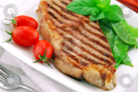 Grilled steak stock photo, Grilled New York steak served on a plate with vegetables by Elena Elisseeva