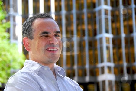 Businessman winking stock photo, Winking businessman by Elena Elisseeva