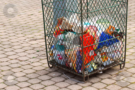 Garbage stock photo, Metal mesh garbage bin in a city park by Elena Elisseeva