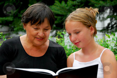Happy family book stock photo, Grandmother and granddaughter reading a book by Elena Elisseeva