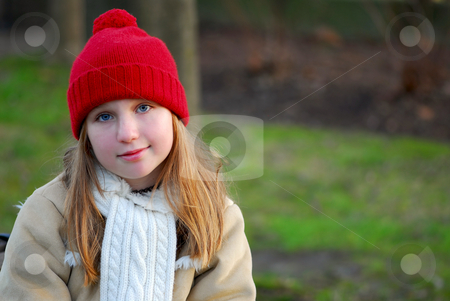 Girl on bench stock photo, Portrait of a young girl sitting on a bench by Elena Elisseeva