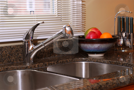 Kitchen interior stock photo, Interior of a modern kitchen with granite counter top and stanless steel double sink by Elena Elisseeva
