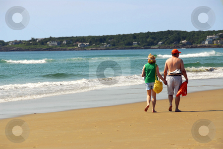 Couple beach stock photo, Mature couple walking on a sandy beach holding hands by Elena Elisseeva