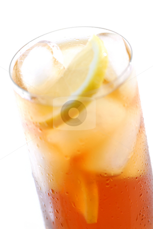 Iced tea stock photo, Glass of cold iced tea with water drops on surface, focus on the drops by Elena Elisseeva