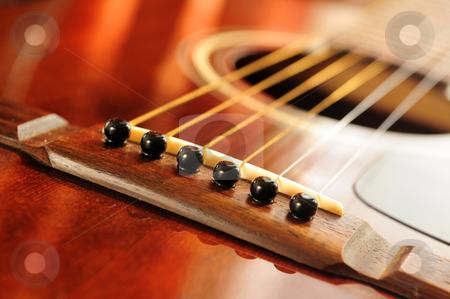 Guitar bridge stock photo, Acoustic guitar bridge and strings close up by Elena Elisseeva