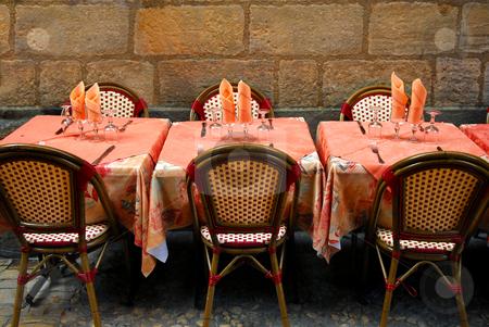 Restaurant patio stock photo, Outdoor restaurant patio on medieval street of Sarlat, Dordogne region, France by Elena Elisseeva