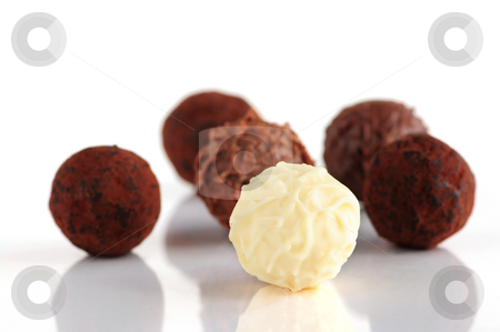 Chocolate truffles stock photo, Several assorted chocolate truffles isolated on white background by Elena Elisseeva