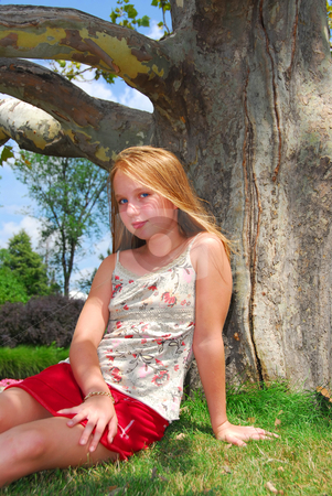 Young girl tree stock photo, Young girl sitting under old big tree in the summer by Elena Elisseeva