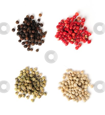 Assorted peppercorns stock photo, Heaps of assorted peppercorns on white background, top view by Elena Elisseeva