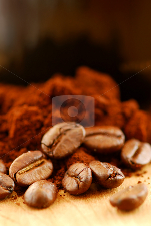 Coffee beans and ground coffee stock photo, Macro image of coffee beans, ground coffee and black coffee cup by Elena Elisseeva