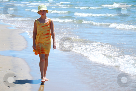 Girl walk beach stock photo, Young girl walking on a beach by Elena Elisseeva
