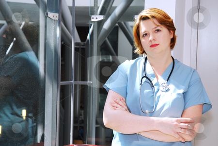 Nurse in a hospital stock photo, Portrait of a nurse in a hospital looking concerned by Elena Elisseeva