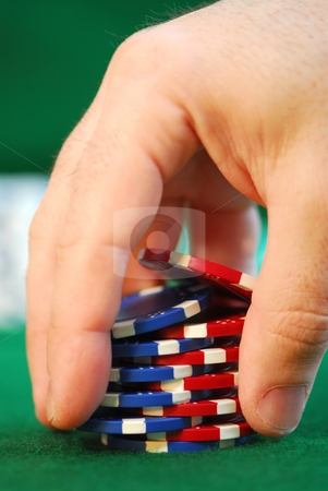 Shuffle stock photo, Close up on man's hand doing a pocker chip trick