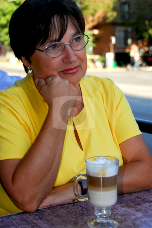 Mature woman coffee stock photo, Mature woman in outdoor cafe with coffee by Elena Elisseeva