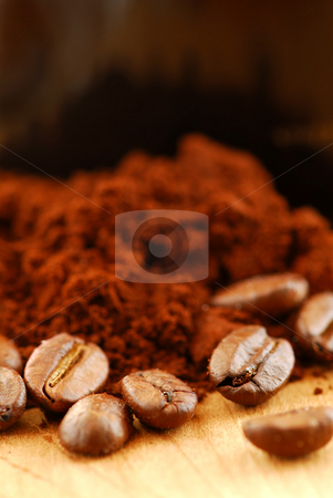Coffee beans and ground coffee stock photo, Macro image of coffee beans and ground coffee by Elena Elisseeva