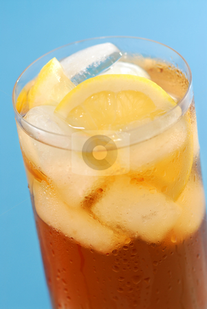 Lemon iced tea stock photo, Glass of cold lemon iced tea with ice and lemon on blue background by Elena Elisseeva