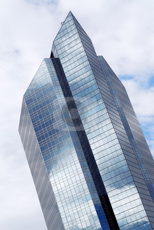 Corporate building stock photo, Corporate building with glass walls reflecting clouds by Elena Elisseeva