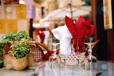 Restaurant patio stock photo, Outdoor restaurant patio on the street of Sarlat, Dordogne region, France by Elena Elisseeva