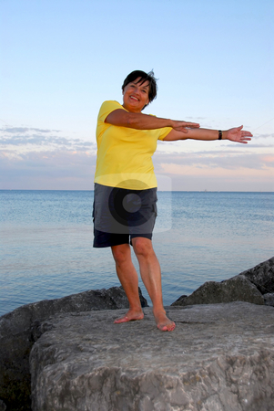 Mature woman exercising stock photo, Mature woman exercising outside by Elena Elisseeva