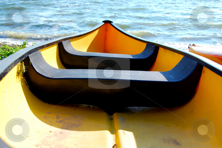 Yellow boat stock photo, Yellow canoe on lake shore by Elena Elisseeva