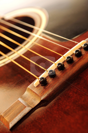 Guitar bridge stock photo, Acoustic guitar bridge and strings close up by Elena Elisseeva