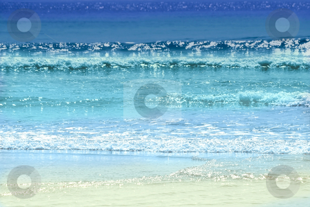 Ocean colors stock photo, Background of colorful ocean waves sparkling in evening sun by Elena Elisseeva