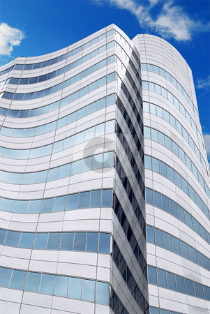 Futuristic skyscraper stock photo, Futuristic corporate building with blue sky reflected in windows by Elena Elisseeva