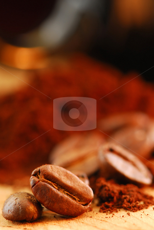 Coffee beans and ground coffee stock photo, Macro image of coffee beans and ground coffee with black coffee cup by Elena Elisseeva